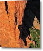 A Rock Climber In A Blue Shirt Climbing Metal Print
