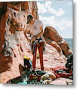 A Rock Climber Setting Up To Climb Metal Print