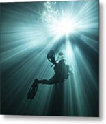 A Scuba Diver Ascends Into The Light Metal Print by Michael Wood