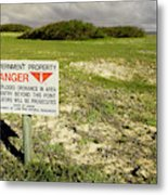 A Sign Warns Of Dangerous Unexploded Metal Print