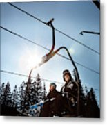 A Skier And Snowboarder Share The Chair Metal Print