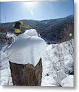 A Snowboarder Jumps Off A Cliff Metal Print