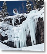 A Snowboarder Jumps Off An Ice Metal Print