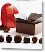 A Still Life Photo Of Gourmet Chocolates Metal Print