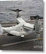 A V-22 Osprey Lands Aboard The Aircraft Metal Print