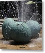 A Water Fountain With Dinosaur Eggs In The Universal Studios Singapore Metal Print