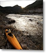A Whitewater Kayak Rests On The Shore Metal Print