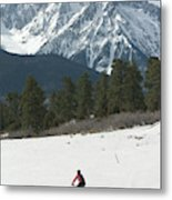A Woman Bike Riding On The  Snow Metal Print