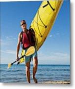 A Woman Carrying Her Sea Kayak Metal Print