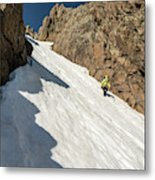 A Woman Descending A Snow Slope While Metal Print