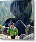 A Woman Hiking High In The Mountains Metal Print