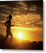 A Woman Jogs Under Sunset Metal Print