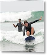 A Woman Learns To Surf Metal Print