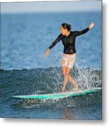 A Woman Rides A Wave On A Longboard Metal Print