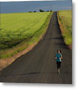 A Woman Running On A Dirt Road Metal Print