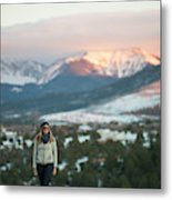 A Woman Stands Against A Snowy Mountain Metal Print