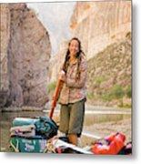 A Woman Unloads Gear From Her Canoe Metal Print