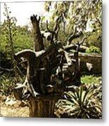 A Wooden Sculpture Inside A Garden Metal Print