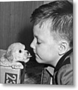 A Young Boy Is Face To Face With A Puppy Tongue. Metal Print