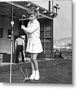 A Young Girl Hits A Golf Ball Metal Print