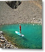 A Young Male Paddleboarding On A Small Metal Print