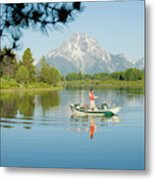 A Young Man Fly Fishes From His Drift Metal Print