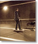 A Young Man On A Skateboard Is Pulled Metal Print