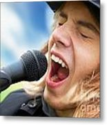 A Young Man Sings To A Microphone Metal Print