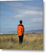 A Young Man Stands In A Field Metal Print