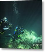 A Young Married Couple Scuba Diving Metal Print by Michael Wood