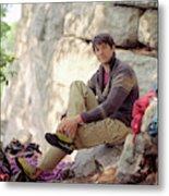 A Young Rock Climber Puts On A Climbing Metal Print