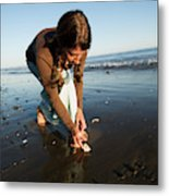 A Young Woman Collects Seashells Metal Print