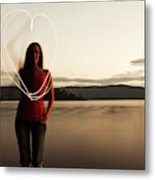 A Young Woman Drawing A Heart At Sunset Metal Print