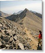 A Young Woman Hikes Borah Peak Metal Print