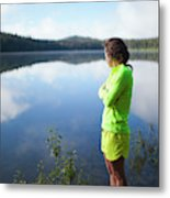 A Young Woman Looks Out Over Unna Lake Metal Print