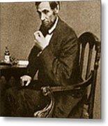 Abraham Lincoln Sitting At Desk Metal Print by Mathew Brady