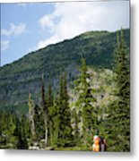 Adult Woman Hiking Through An Alpine Metal Print