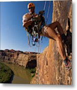 Adventure Racer Rappelling Over A River Metal Print