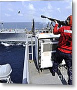 Airman Fires A Shot Line From Uss Metal Print