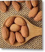 Almonds On A Spoon With Brown Background Metal Print