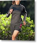 An Athletic Woman Trail Running Metal Print