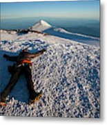An Exhausted Climber Lies On The Summit Metal Print