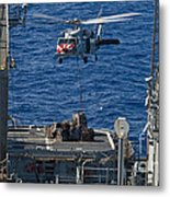 An Mh-60s Sea Hawk Delivers Supplies Metal Print