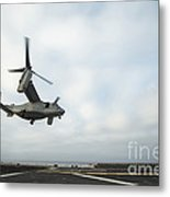 An Mv-22 Osprey Is Guided Onto Metal Print by Stocktrek Images