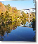 Arched Bridge Over Blue Water Metal Print