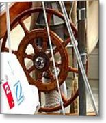 At The Wheel Metal Print