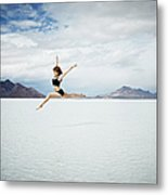 Ballerina Leaping In Mid-air Over Lake Metal Print