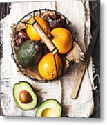 Basket With Avocado, Oranges And Dates Metal Print