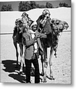 Bedouin Camel Minder Recieves Call On A Mobile Phone With Camels In The Sahara Desert At Douz Tunisia Metal Print