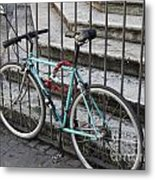 Bicycle Is Chained To A Fence Metal Print